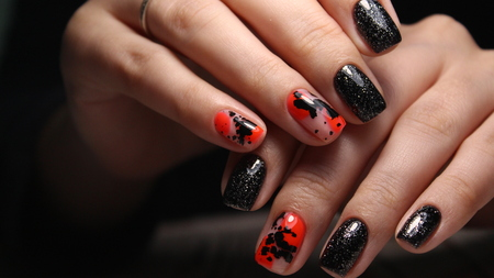 beautiful red nails on a trendy texture background