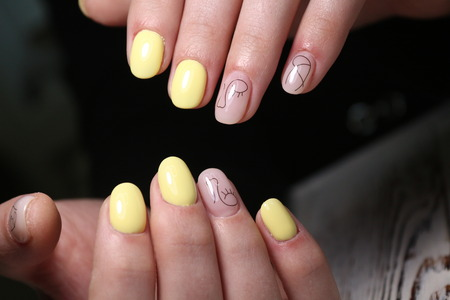 fashion manicure of nails on a beautiful textural background