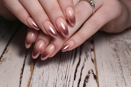 Stylish manicure nails on a beautiful textural background