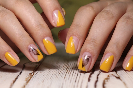 beautiful gel lacquer manicure on a textured trendy background