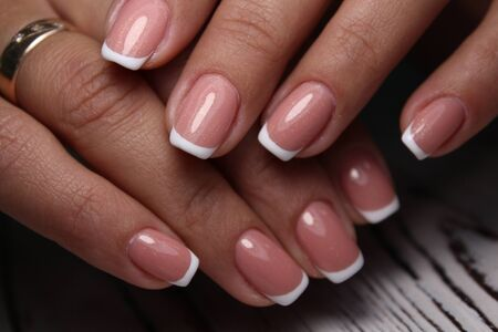 Beautiful nail design on female hands on background. Reklamní fotografie