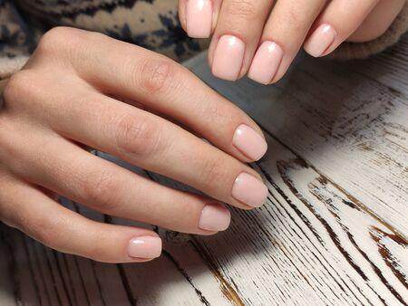 Trendy manicure design on a beautiful textural background. Foto de archivo