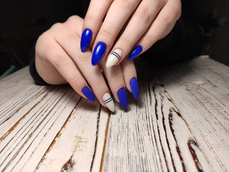 Colorful Christmas nails winter nail designs with glitter,rhinestones, on short and long female nails. 写真素材 - 133674969