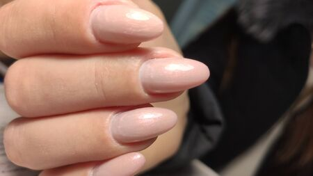 Trendy manicure design on a beautiful textural background.