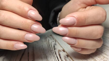 Amazing natural nails. Womens hands with clean manicure. Gel polish applied.