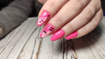 fashionable beige manicure with a silver pattern design 写真素材