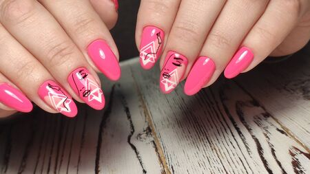 Design sexy pink manicure on long beautiful nails 写真素材