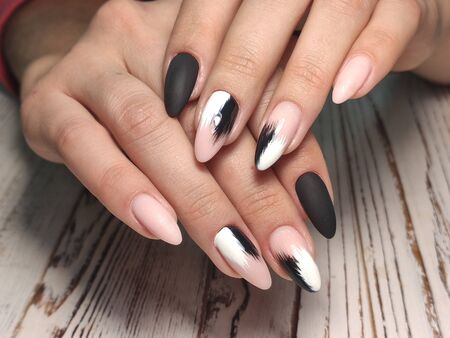 glamorous manicure of nails on beautiful female hands 写真素材