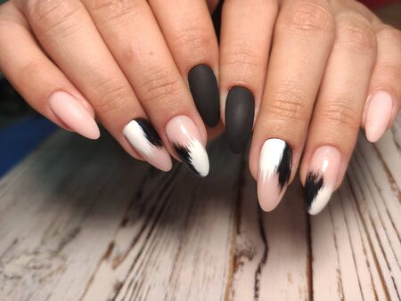 beautiful gel lacquer manicure on a textured background 写真素材