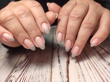 glamorous manicure of nails on beautiful female hands Archivio Fotografico