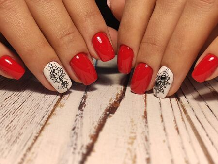 beautiful nail art manicure on the background of a fashionable texture