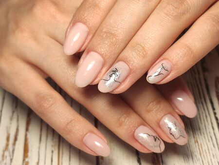beautiful manicure of nails on the background of a fashionable texture Imagens