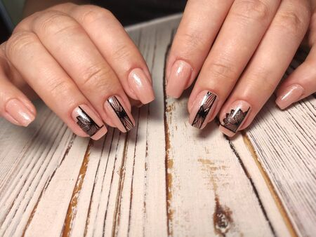 beautiful manicure of nails on the background of a fashionable texture Archivio Fotografico