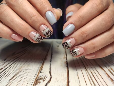 beautiful manicure of nails on the background of a fashionable texture
