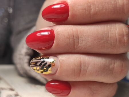 Beautiful nail design on female hands on background. 2019
