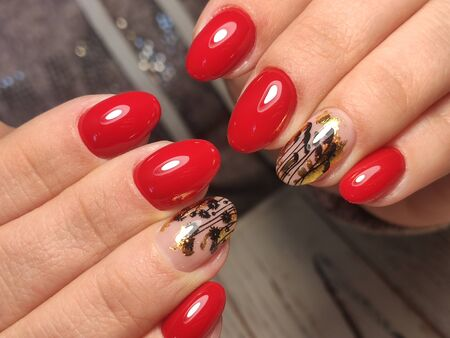 Design sexy red manicure on long beautiful nails