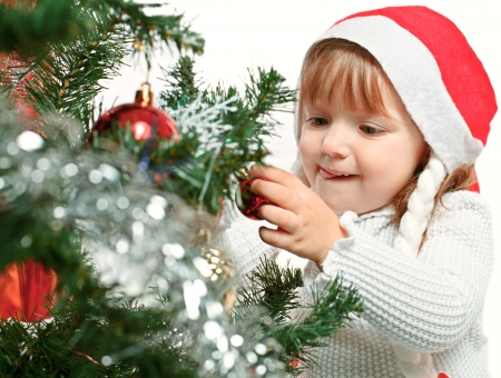 beautiful girl on a background of the Christmas tree