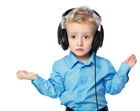 cheerful boy listening to music with headphones on white background Stock Photo