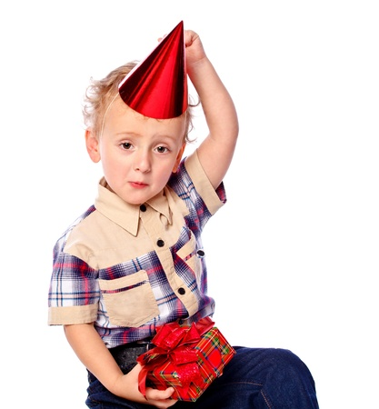 portrait of a little boy holding a gift, isolated
