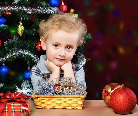 boy on the background of the Christmas tree Stock Photo