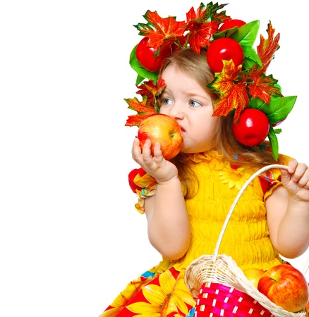 beautiful little girl eating apples on an abstract background Stock Photo - 17080003