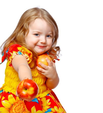 beautiful little girl eating apples on an abstract background