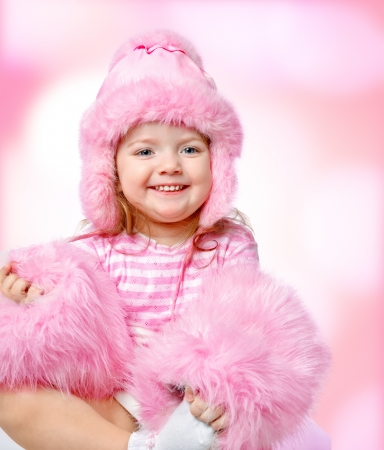 portrait of a beautiful girl on an abstract background, dressed in fur