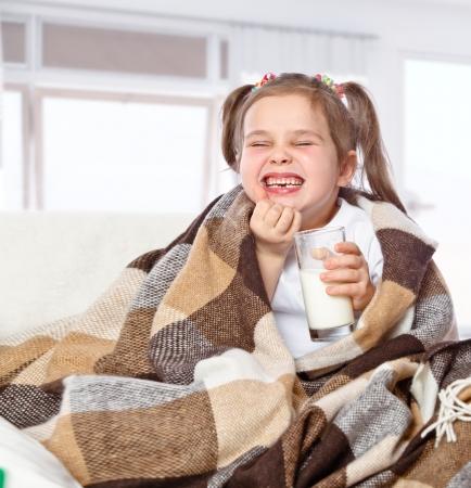 Beautiful girl drinking milk, isolated on  background Stock Photo - 17289473