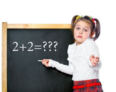 girl standing at the blackboard, isolated Stock Photo