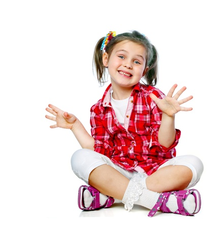 splayed: Portrait of a cheerful girl sitting on the floor isolated Stock Photo