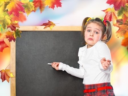 schoolgirl wrote in chalk on the chalk board, on an abstract background
