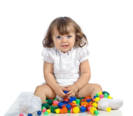 beautiful girl playing with toys on a white background