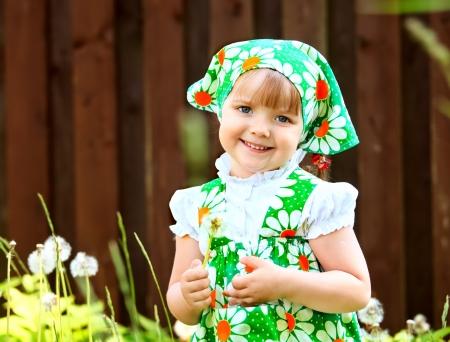 girl holding a dandelion