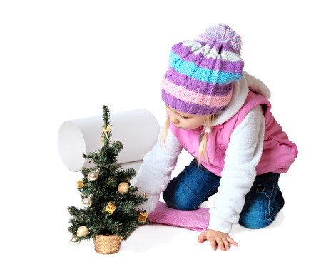 portrait of a little girl sitting near a Christmas tree with santa claus, christmas, new year