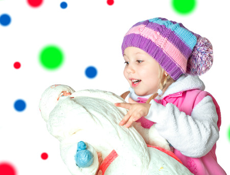 portrait of a little girl holding santa claus, christmas, new year, winter
