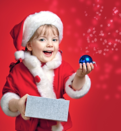 portrait of a little girl dressed in Santa Claus, Christmas, gift package