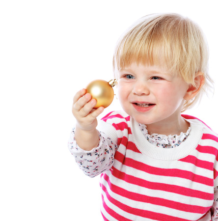 portrait of a little girl holding a Christmas bal Stock Photo