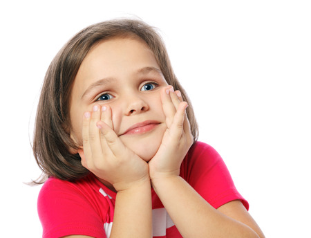 portrait of a pretty little girl in red shirt on a white background  Stock Photo