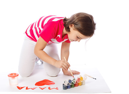 little girl draw, paint, heart, Valentines Day, March 8 Stock Photo