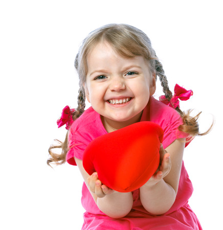 little girl holding two hearts on the white background