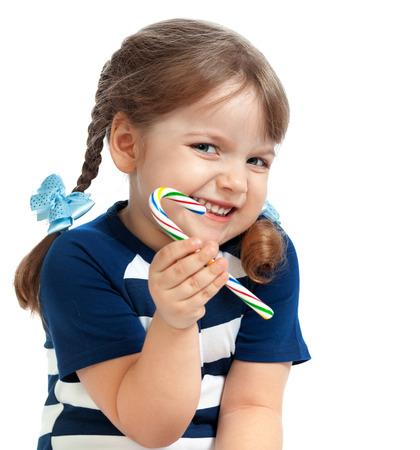 beautiful little girl eating candy sweetness