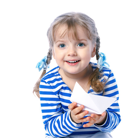 portrait of a beautiful little girl playing in the boats, map, travel, game Stock Photo