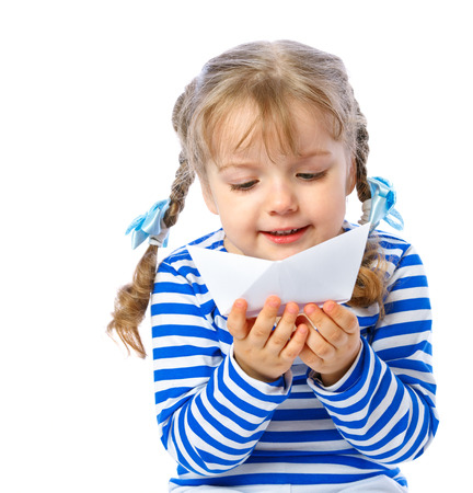 portrait of a little girl holding a paper boat on a white background, travel, cruise, swimming