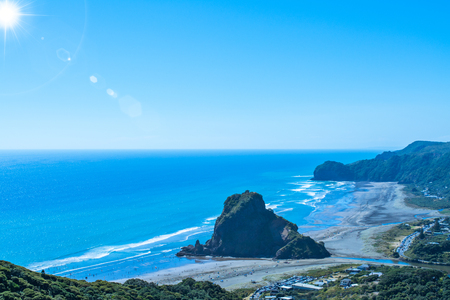 View over Piha beach, mighty Lion Rock in the centre, on the West coast of Auckland, New Zealand