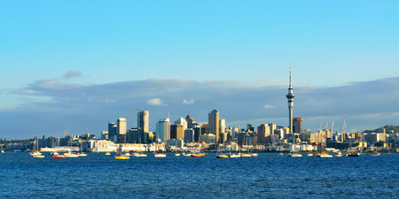 Panoramic view of Auckland City and Auckland port at sunset. View from Harbour Bridge. Selective focus