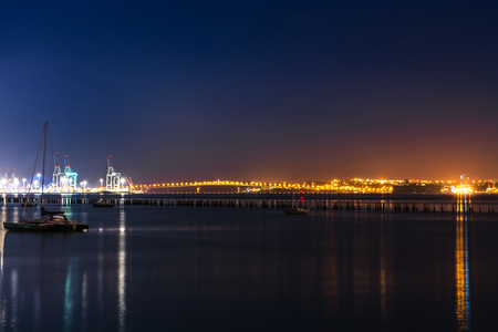 View over Auckland harbour and sea port at night Stock Photo