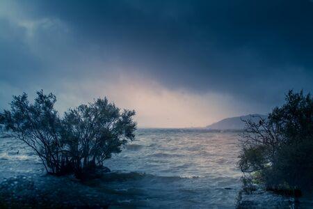 Retro style photo of the storm at lake Rotorua. Angry waves and gloomy sky. Toned image. Soft focus Banco de Imagens - 130815375