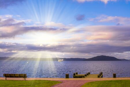 A seaplane speeds up to take off on a sightseeing excursion from the lake Rotorua at sunset. North Island, New Zealand