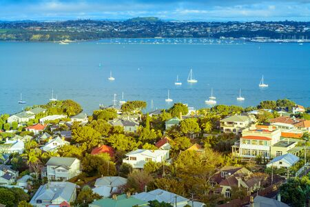 Glowing evening over historical suburb of Devonport and Auckland Harbour
