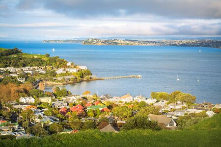 Auckland Harbour and historical suburb of Devonport basking in glorious sunset. Auckland, New Zealand. 版權商用圖片